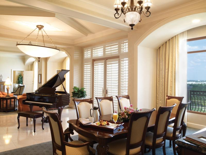 A baby grand piano graces the sleek and sophisticated Ibis Presidential Suite.