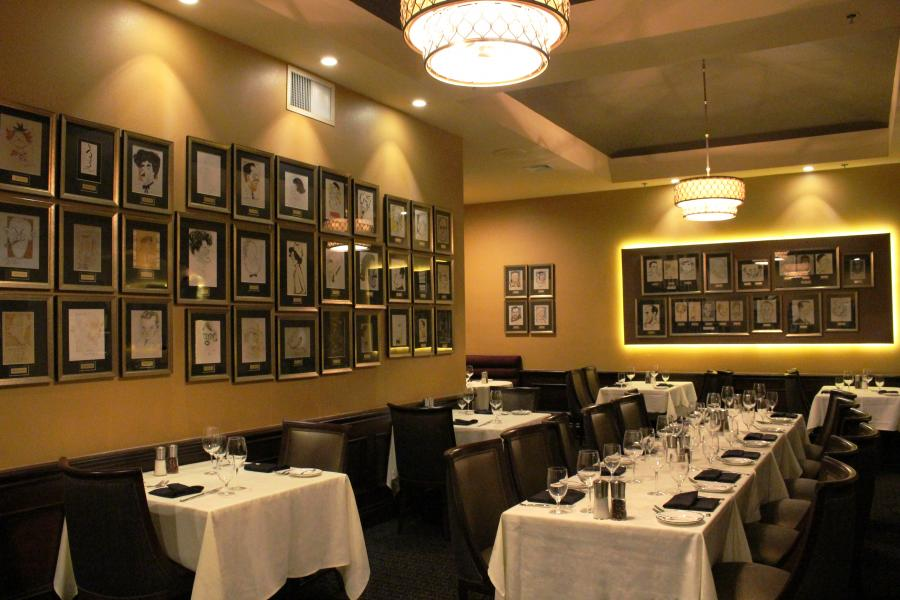 Hundreds of autographed caricatures of VIPs and celebrities provide dining
