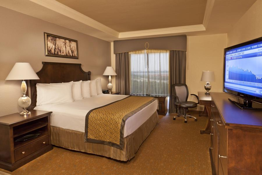 Rosen Plaza's stately Presidential Suite adjoining king guestroom.