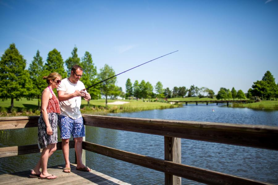 Guests enjoy seasonal fishing amid the lush natural surroundings at Rosen Shingle Creek.