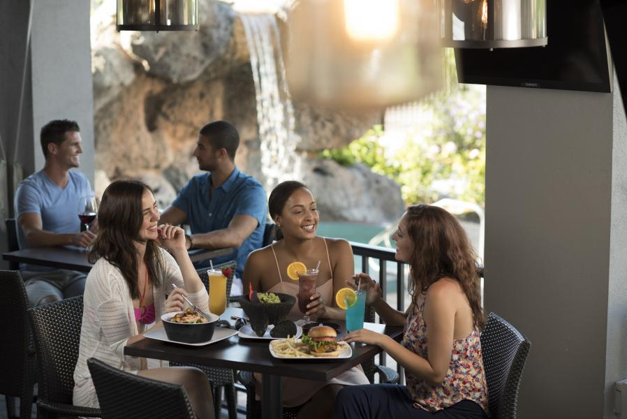 '39 Poolside Bar & Grill, where guests enjoy poolside dining and Sunday brunches.