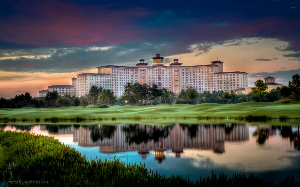 Morning dew and calm waters accent the beauty of sunrise at Rosen Shingle Creek.