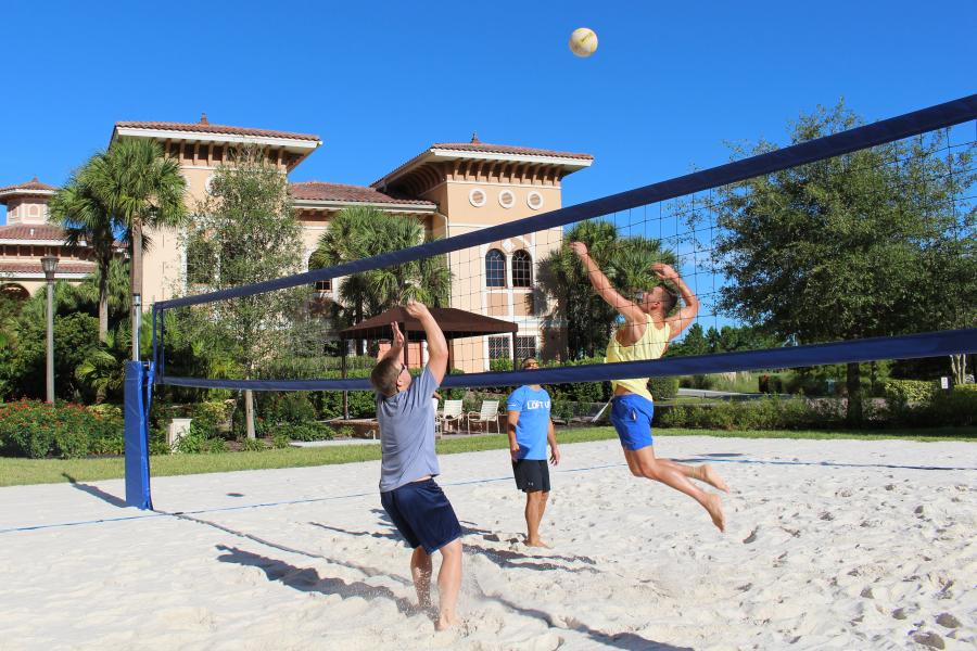A regulation-size sand volleyball court offers one of numerous outdoor activities.
