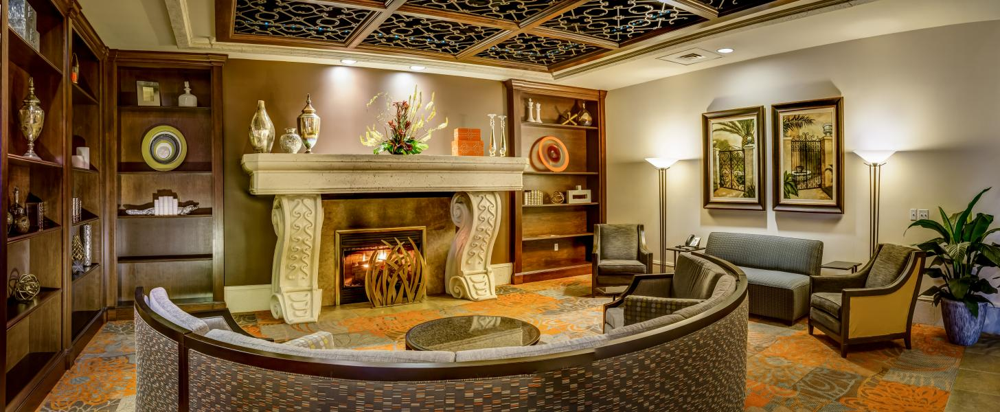 An intimate study off the lobby beckons guests with a fireplace and cozy seating.