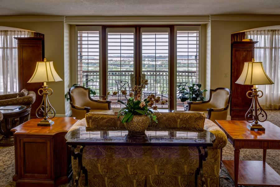 The Grande Parlor is highlighted by spectacular views from the adjoining outdoor balcony.