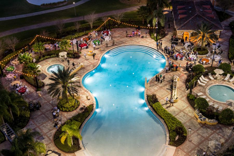Taking advantage of balmy Orlando breezes with a poolside nighttime event.