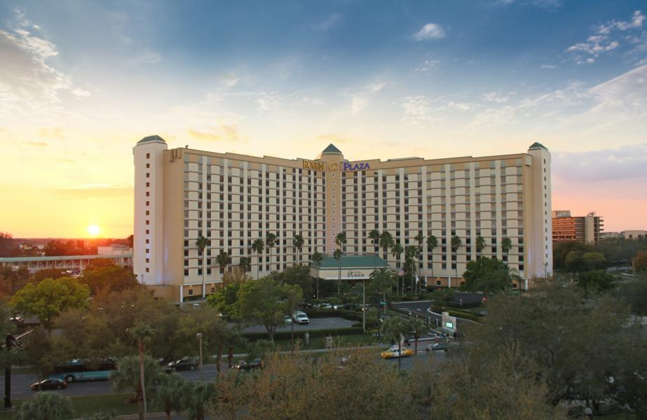 Twilight at Rosen Plaza, showing the Gary Sain Memorial Skybridge to the left of the building.