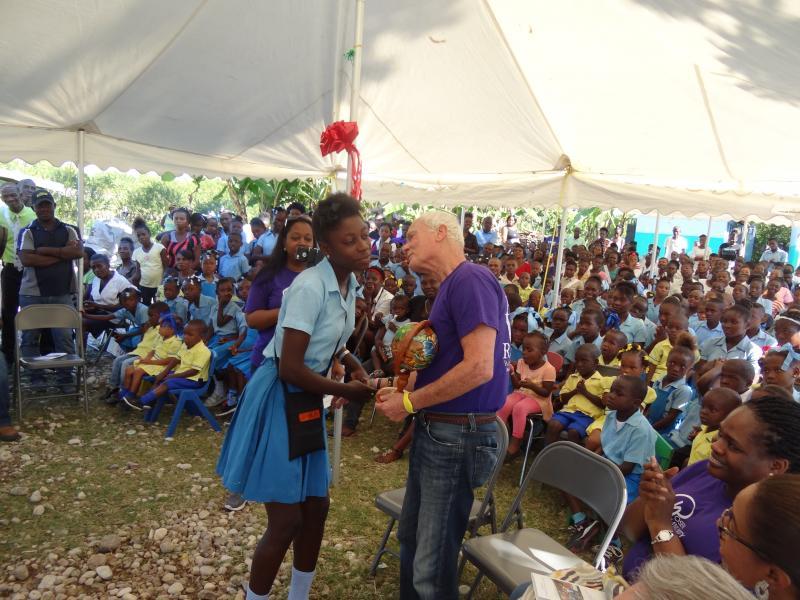 Dec. 2017 (Haiti) A young Haitian youth thanks Harris Rosen with a globe.