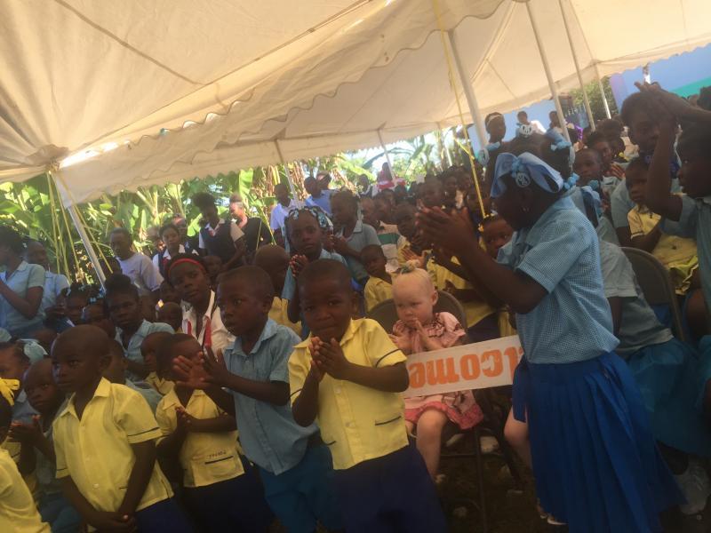 Dec. 2017 (Haiti) Haitian schoolchildren gather for the dedication of their new school built by Harris Rosen.