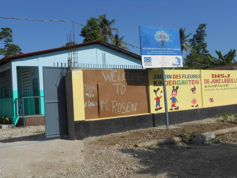 Dec. 2017 (Haiti) A few words of thanks for the Harris Rosen school, peaking from behind the signage.