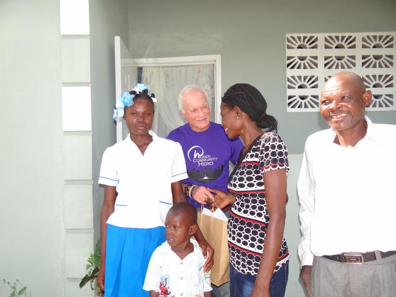 Dec. 2017 (Haiti) Harris Rosen visits one of the families whose home he rebuilt in Haiti.
