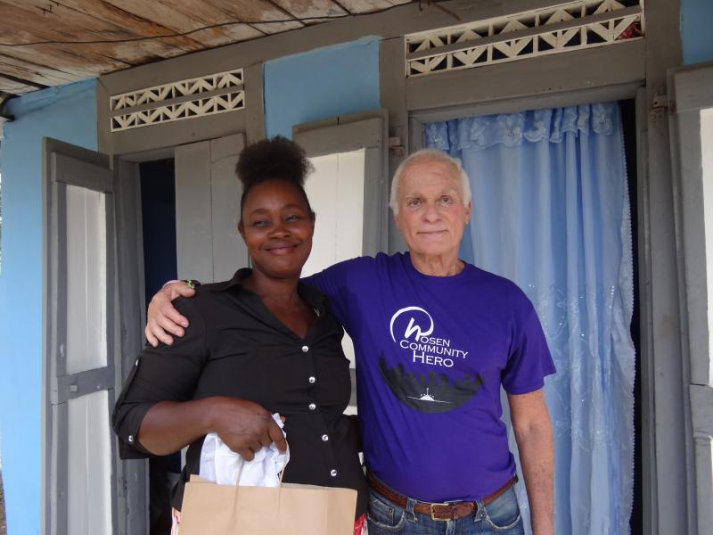 Dec. 2017 (Haiti) Harris Rosen visits with one of the happy new homeowners in Haiti.