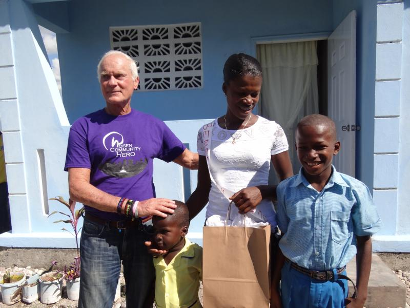 Dec. 2017 (Haiti) Harris Rosen visits an excited new homeowning family in Haiti.