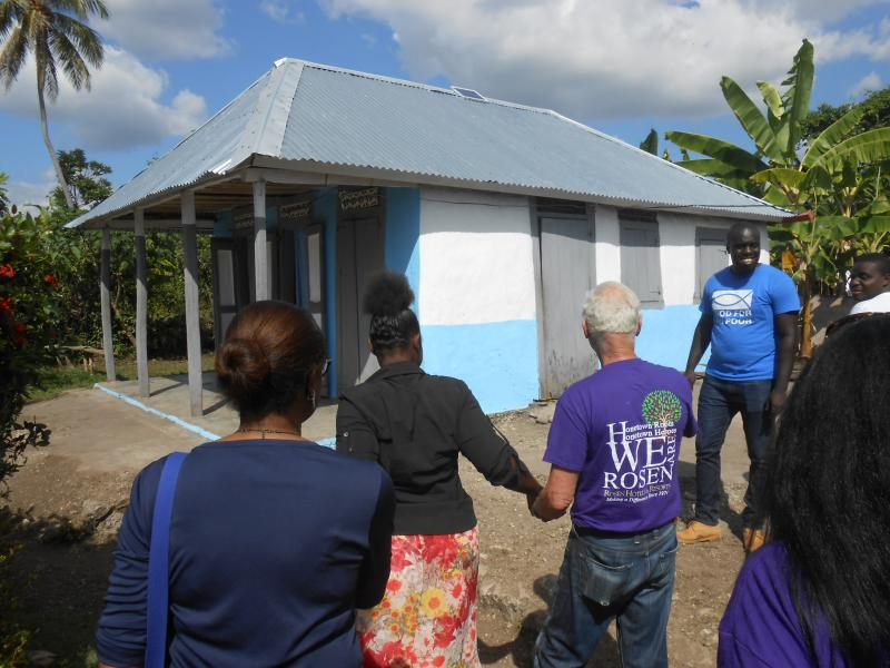 Dec. 2017 (Haiti) Excited to show Harris Rosen the new hurricane-resilient home he built for her family in Haiti.