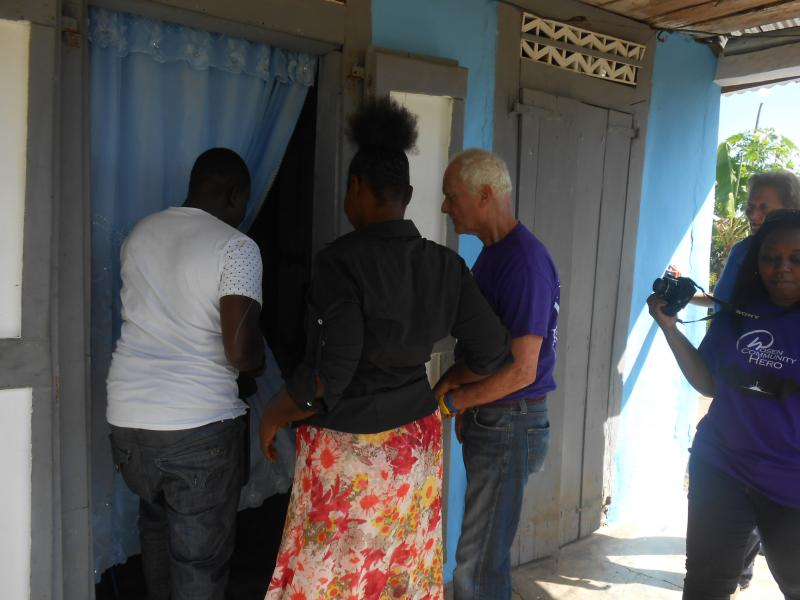 Dec. 2017 (Haiti) An excited new homeowning family tours Harris Rosen in the new Haitian home he built for them.