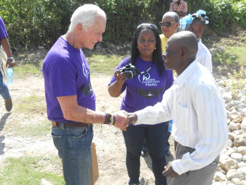 Dec. 2017 (Haiti) A new Haitian homeowner thanks Harris Rosen for his benevolence.