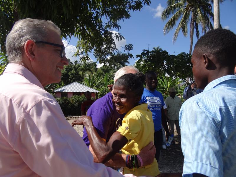Dec. 2017 (Haiti) Hugs abound as more than 100 new homeowners thank Harris Rosen for his generosity.