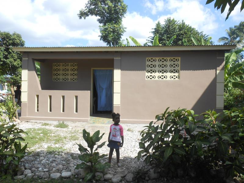 Dec. 2017 (Haiti) In front of her new home, built by Harris Rosen.
