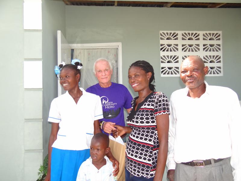 Dec. 2017 (Haiti) Smiles all around as a family shows Harris Rosen their new home in Haiti.