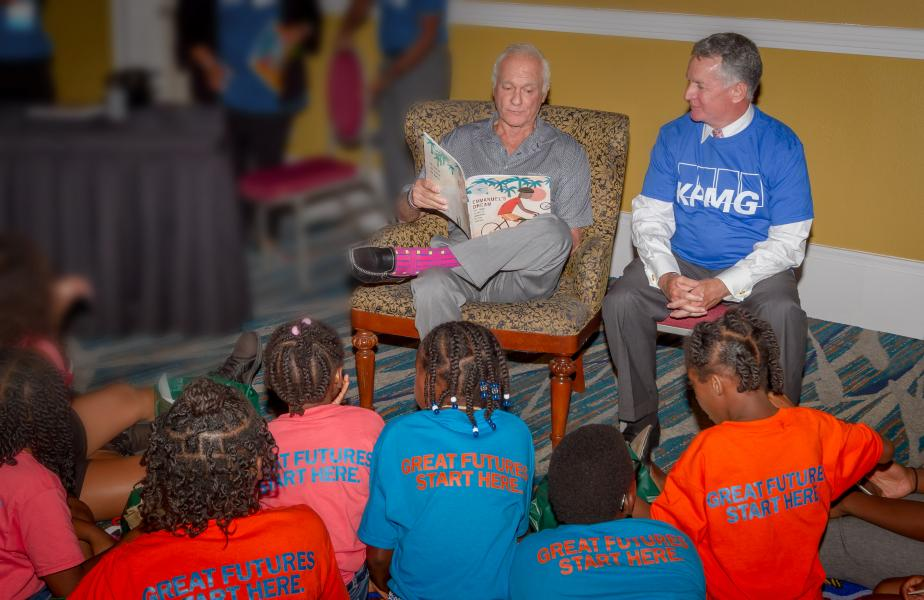 Harris Rosen reading to the children with Gary Cain,President/CPO at Boys and Girls Clubs of Central Florida