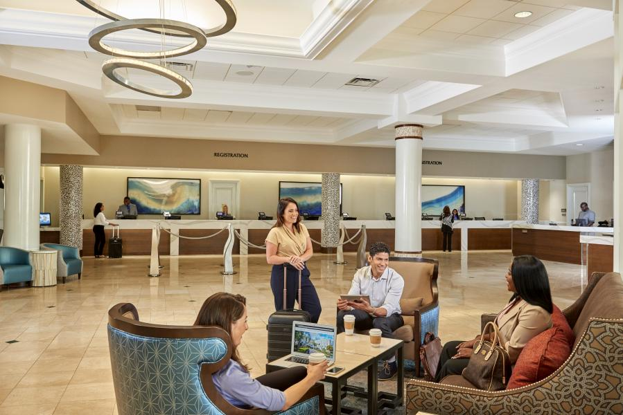 New contemporary, chic furnishings welcome guests to Rosen Plaza's lobby.