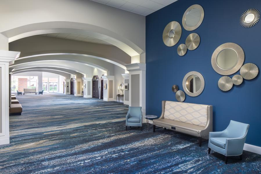 The Executive Ballroom Foyer features new decor and carpeting for a chic new look.