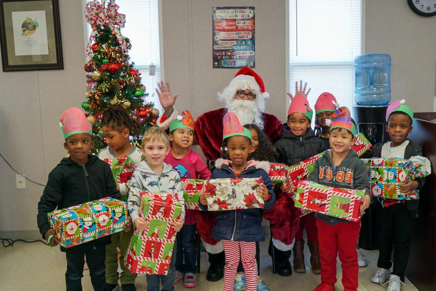 Dec., 2019 -- Youngsters at the Tangelo Park Preschool can't wait to open holiday gifts, a generous donation from SiteOne, who hosted a CSR event during their annual conference at Rosen Shingle Creek.
