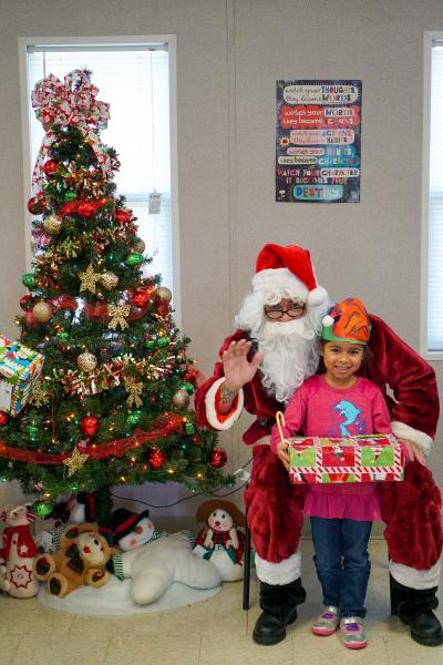 Dec., 2019 -- A Tangelo Park Preschooler visit Santa, courtesy of a CSR project by Site One during their annual conference at Rosen Shingle Creek.